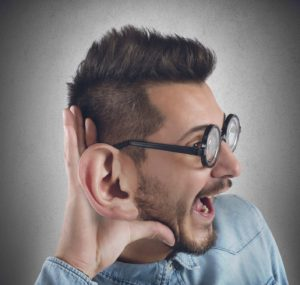 Nerd man listens with curiosity a gossip